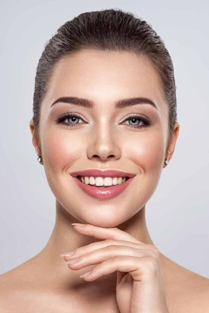 front-portrait-of-the-smiling-woman-with-beauty-fa-7MMD5WU.jpg